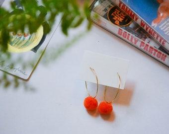 Orange Pom Pom Hoop Earrings