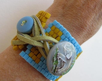 Yellow Brick Road to Africa cuff corset bracelet with leather tie and handpainted elephant button closure
