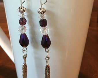 Purple feather dangle earrings
