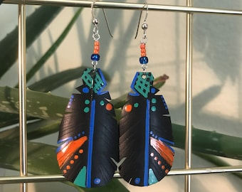 Handmade upcycled feather earrings made from recycled bike tubes