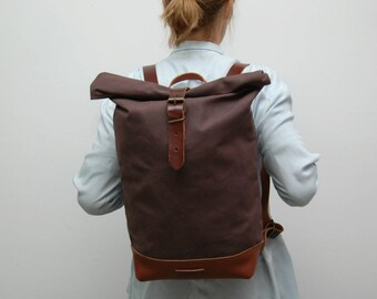 waxed Canvas rucksack/backpack,bronze  color, hand waxed , with handles, leather base and closures