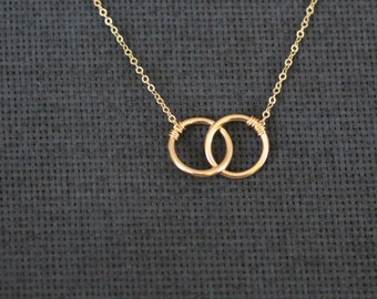 delicate necklace, delicate gold necklace, gold circles, two circles, intertwined circles, connected circles, small necklace, small circles