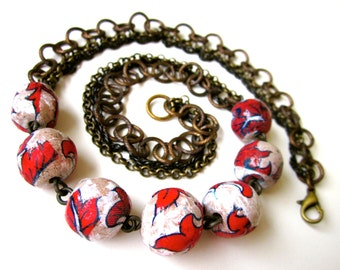 Desperate Can Be Wonderful if You Can Stand It - weathered bright red blue white ceramic art bead and triple chain oxidized brass necklace