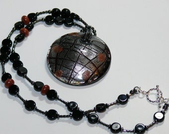 Round Lampworked Glass Black/Silver/Copper Pendant on Black Beaded Handmade Necklace