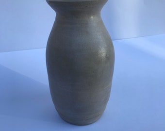 Tall waxy white vase