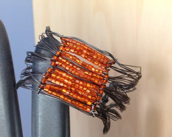 Wire Strand Bracelet with Orange Beading