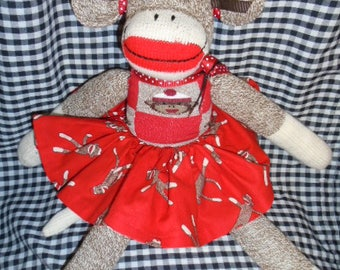 Sock Monkey Girl Doll Dressed In Monkey Skirt And Sweater