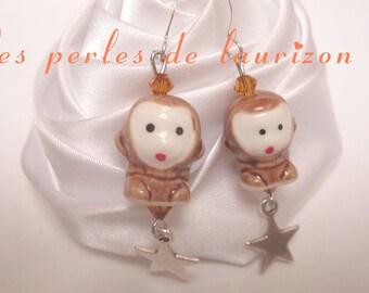 These earrings my pettit Brown monkey