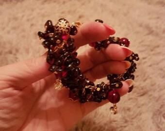 Garnet bracelet with gold jewelry elements