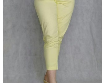 Vintage 1950s style lemon yellow stretch cigarette pants, high waisted.