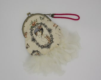 Hand bag with nozzle and feathers, clutch