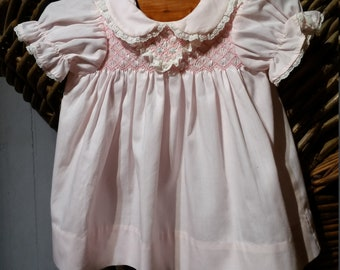 Free Shipping - An aeorable little baby girl, pink Polly Flinders, hand smocked vintage dress,  6 - 12 months.