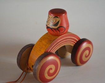 Daruma on wheels, solid wood,  folkcraft toy