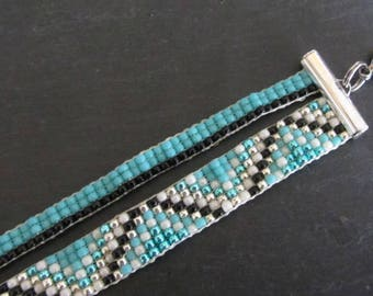 TOHO / turquoise, white, silver and black woven beaded bracelet