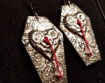 True love never dies...Dracula-inspired earrings