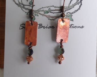 copper drop earrings with natural fire patina, and crystal and copper beads.  handmade , one of a kind .