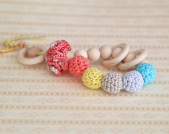 Teething toy rattle with crochet wooden beads and 3 wooden rings. Yellow, coral,baby blue, aqua blue/ cyan, beige.