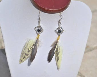 yellow and black feather earrings