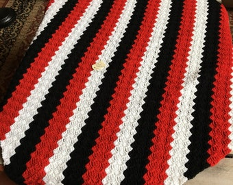 no. 46 Crocheted lap afghan in black, red and white
