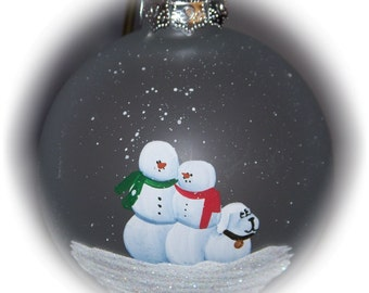 """Our family with a snow dog hand painted on a 3 1/4"""" frosted glass ornament."""