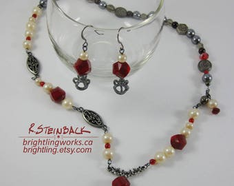 Red Queen; Necklace & Earring Set in Pewter and Gunmetal, Glass Pearls, Spiral Faceted Ruby Glass with Crown Accents and Side Magnetic Clasp