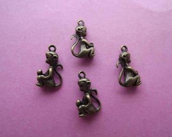 6 small charms monkeys 3 D metal bronze