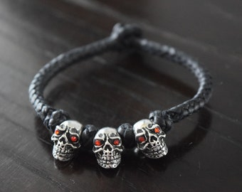 Men Braided leather and .925 Sterling Silver Skulls with red zirconias handmade.