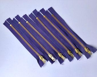 Liquidation of zippers purple 16 cm