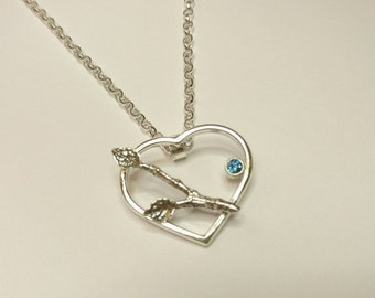 Sterling silver handmade heart and branch necklace with a 3mm iridescent aqua faced gem stone.