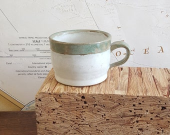 White Ceramic Tea Cup with Green Handle and Matte Finish