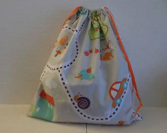 pouch for baby with childlike drawings on grey background