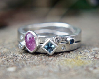 """Recycled sterling silver """"Evolve"""" ring set. Ethical lab grown moissanite, fair-trade untreated ruby, aquamarine. UK size M"""
