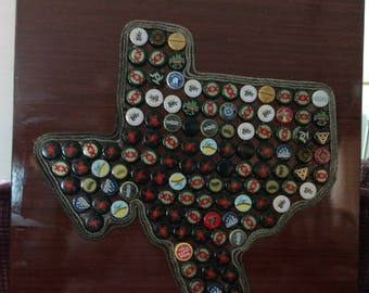 large wall plaque with state of texas out of bottle caps outlined with rope