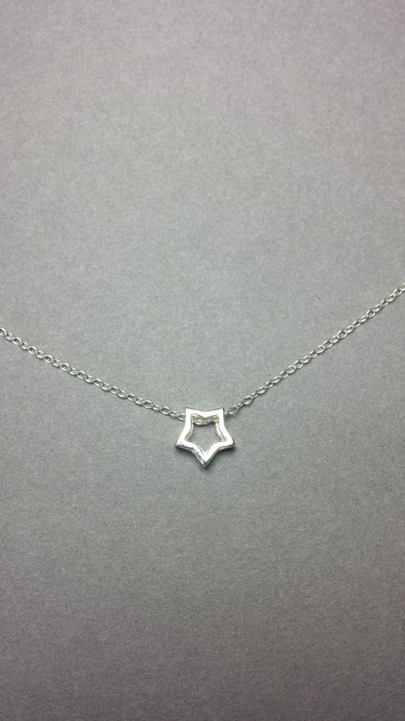 Tiny star necklace sterling silver star pendant floating like this item mozeypictures Image collections