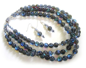 Moonlight Sonata: 'Blue Moon' glass, sterling silver. Necklace and earring set.