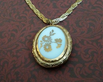 Large vintage gold floral locket on braided gold chain