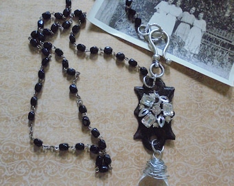 Assemblage necklace with black rosary beads keyhole and chandelier prism
