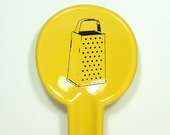 spoon rest featuring a cheese grater.  Made to Order/Pick Your Colour
