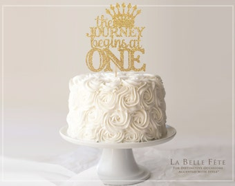 The JOURNEY BEGINS at ONE gold glitter cake topper