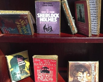 Collection of 7 Sherlock Holmes books for dolls houses with opening pages