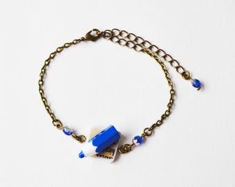 Blue pencil and writing vintage bracelet
