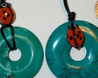 Turquoise Donut Pendant with glass bead on Adjustable Leather
