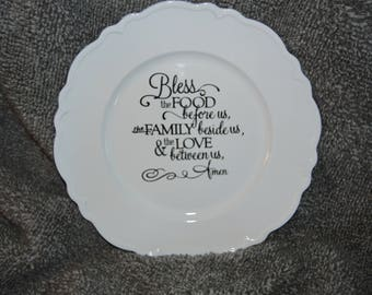 Bless the food before us, the family beside us, and the love between us, Amen plate