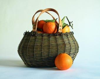 Oval green wicker basket purse