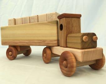 Heavy hauler toy truck with wooden blocks
