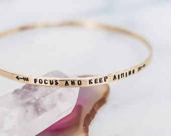 Focus and keep aiming quote bangle. Inspirational jewelry. Inspirational gift. Hand stamped bangle. Stacking mantra bracelet. RTS BB002