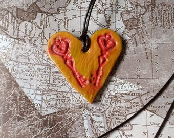 Heart and key shaped pendant