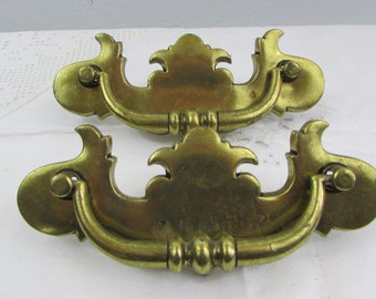 Two brass drawer handles