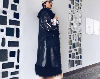 Long black faux-leather and faux-fur vest