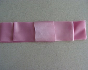 Pink satin bow to decorate girl dress